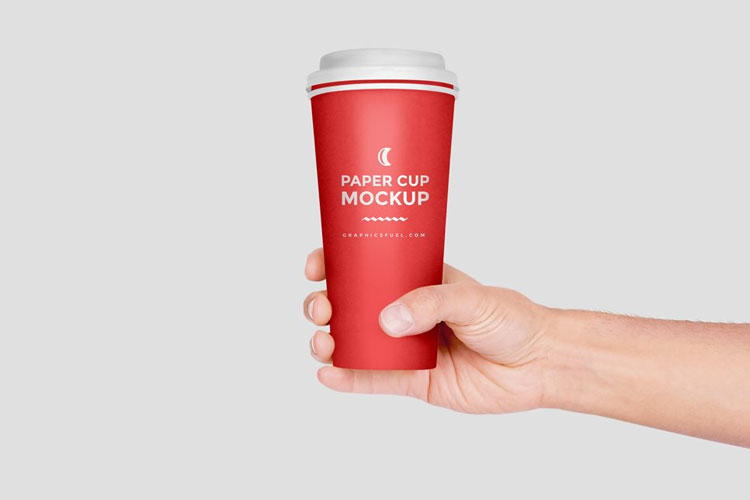 Free-Paper-Cup-in-Hand-Mockup