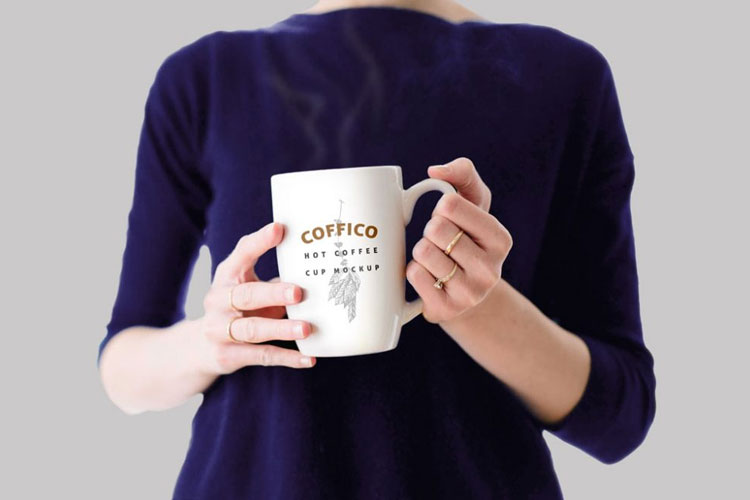Free-Woman-holding-Coffee-Mug-Mockup