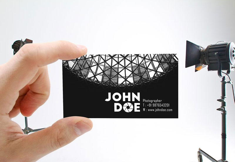 Male-Hand-holding-Business-Card-Mockup