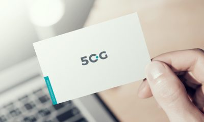 Free-Man-Showing-Business-Card-in-Hand-Mockup-600