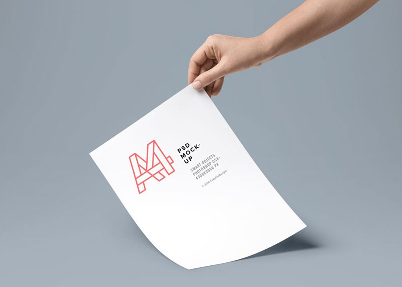 Hand-holding-A4-Paper-Mockup