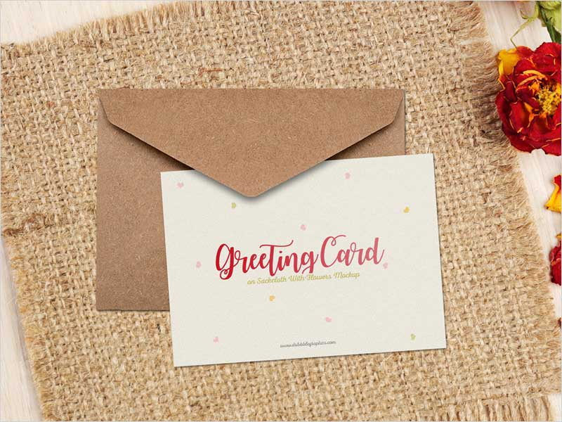 Free-Greeting-Card-on-Sackcloth-With-Flowers-Mockup