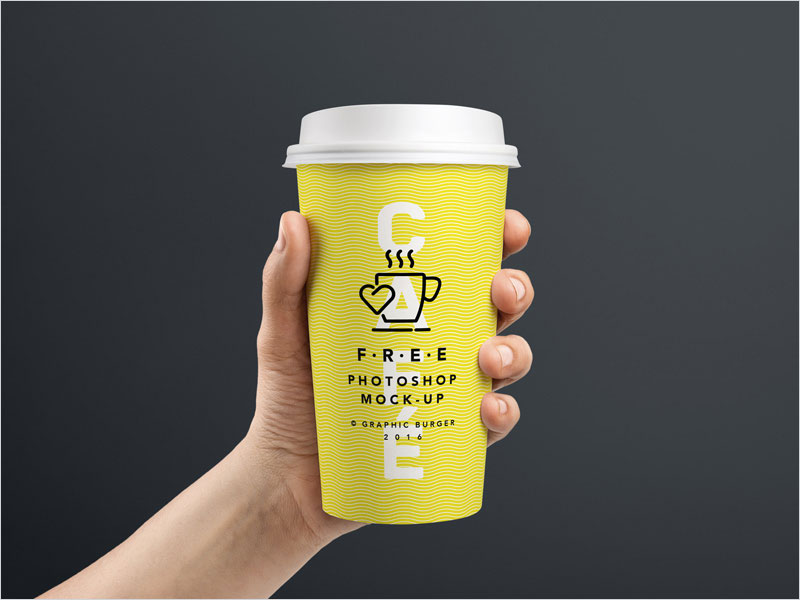 Free Hand Held Coffee Cup Mockup