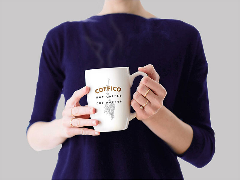 Woman-Holding-Coffee-Cup-Mockup