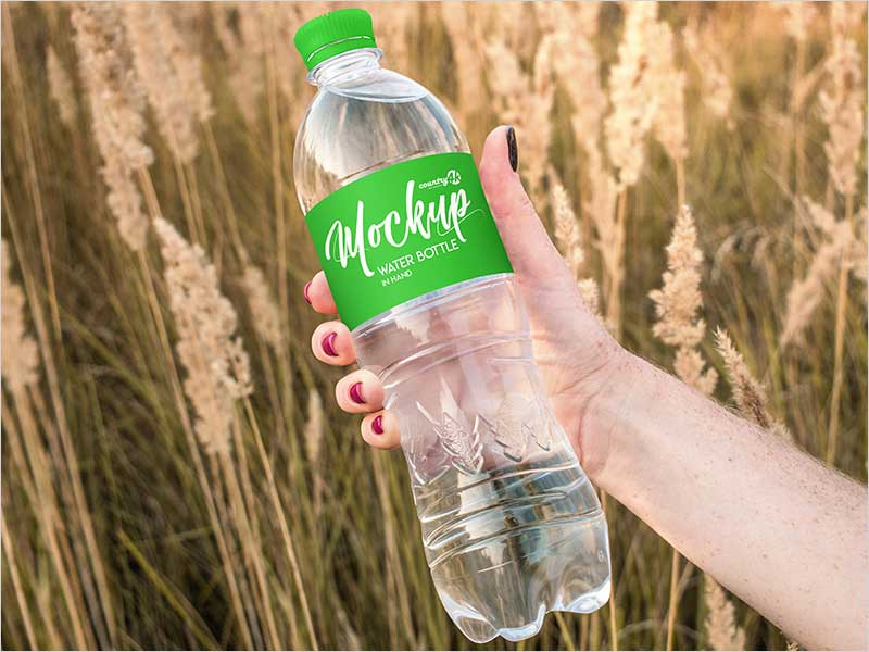 Free-Water-Bottle-in-Hand-PSD-MockUp-in-4k