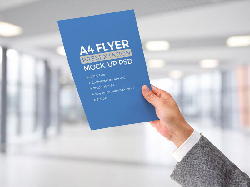 Free-A4-Paper-In-Male-Hand-Mockup-Psd