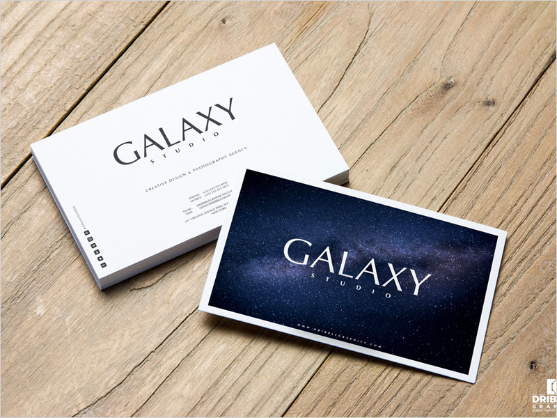 Free-Business-Cards-On-Wooden-Background-Mockup