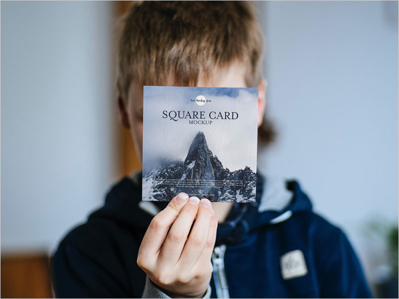 Free-Little-Boy-Showing-Square-Card-Mockup-PSD
