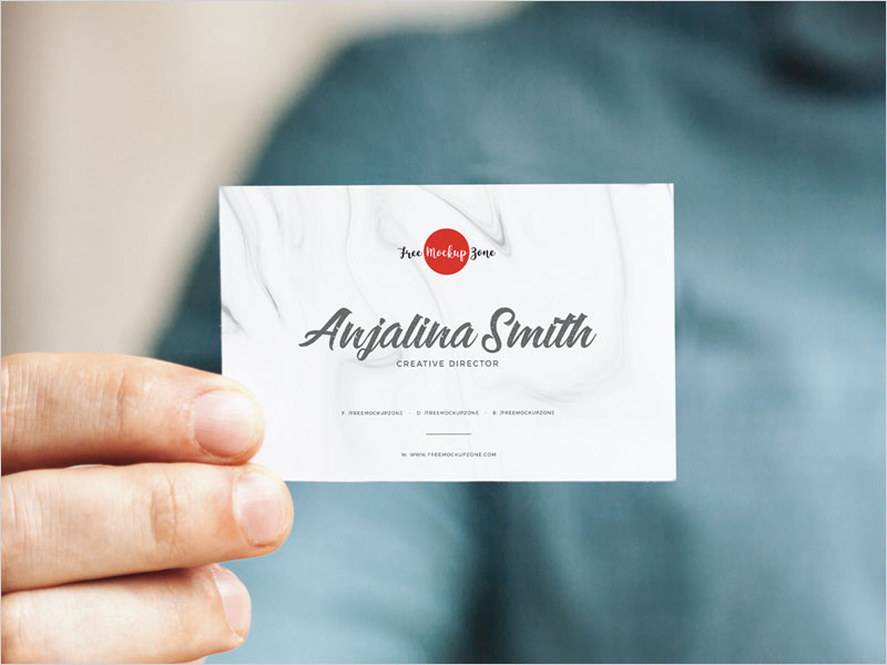 Free-Man-Holding-In-Hand-Business-Card-Mockup
