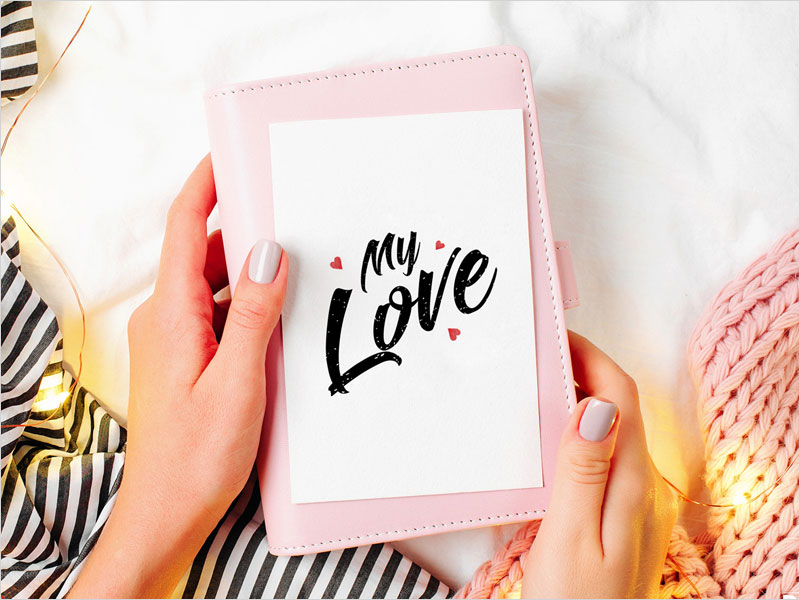 Free-Girl-Holding-Beautiful-Greeting-Card-Mockup-Psd