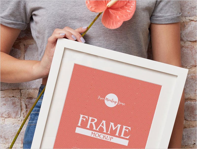 Free-Girl-Showing-PSD-Frame-Mockup-Design