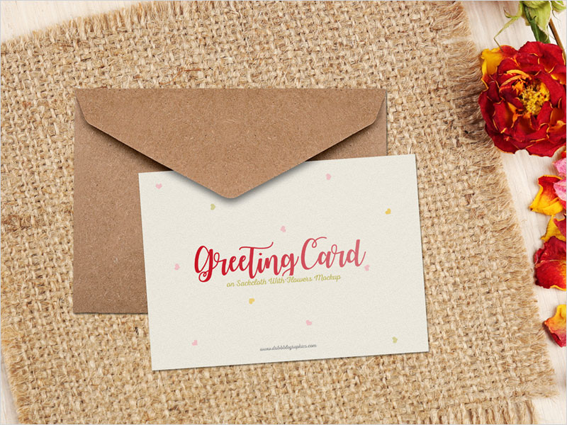 Free-Greeting-Card-on-Sackcloth-With-Flowers-Mockup-PSD