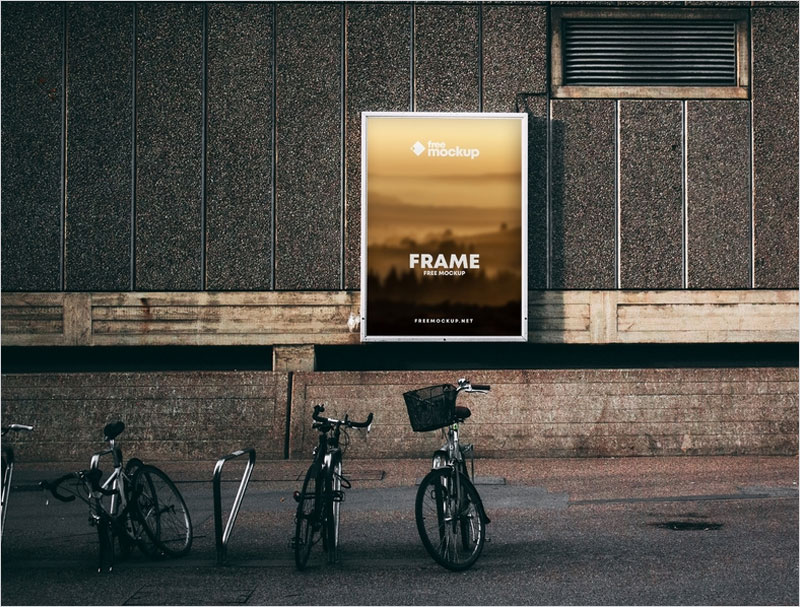 Poster-Frame-in-Street-with-Bikes-Free-Mockup