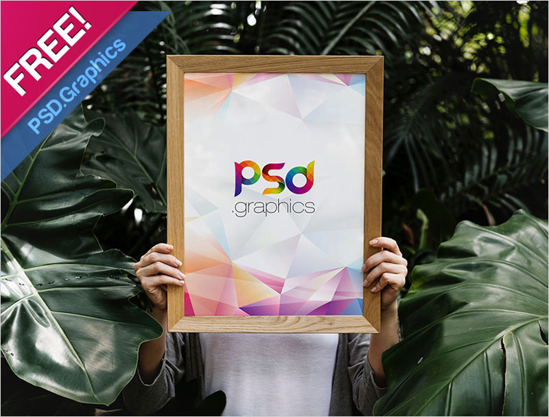 Woman-Holding-Wooden-Poster-Frame-Mockup