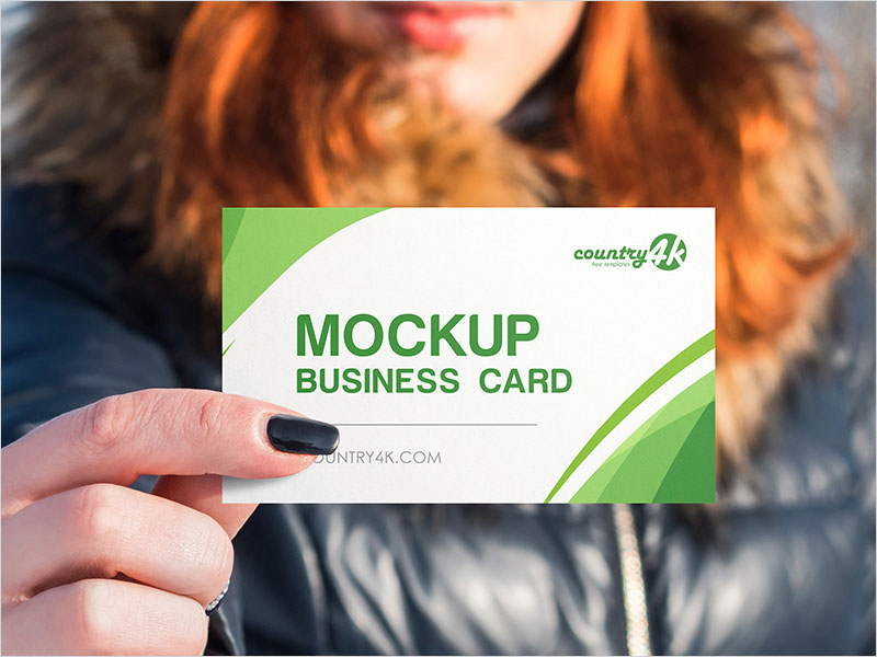 Free-Business-Card-in-Hand-PSD-MockUp