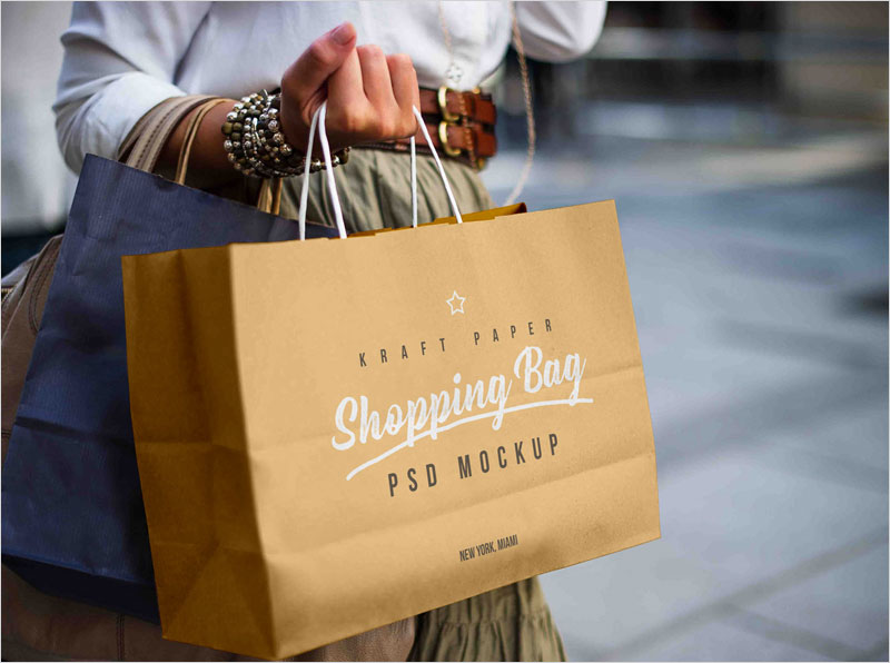 Free-Female-Holding-Shopping-Bag-Mockup-PSD