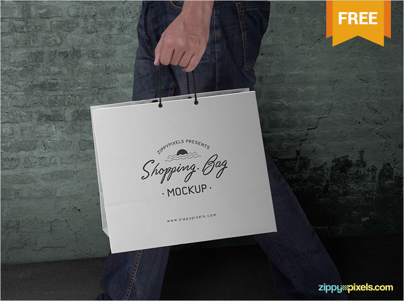 Free-Shopping-Bag-in-Hand-Mockup-PSD