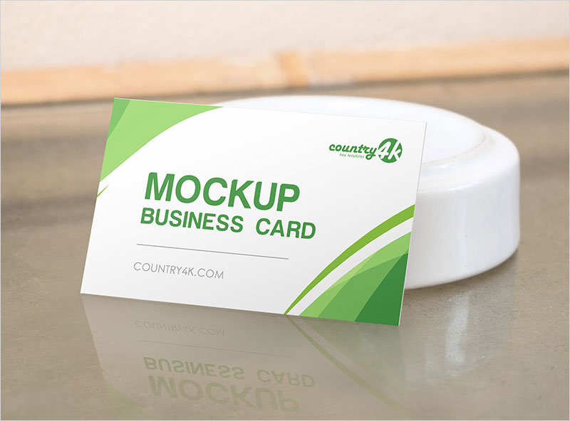 Free-Business-Card-on-the-Table-PSD-MockUp