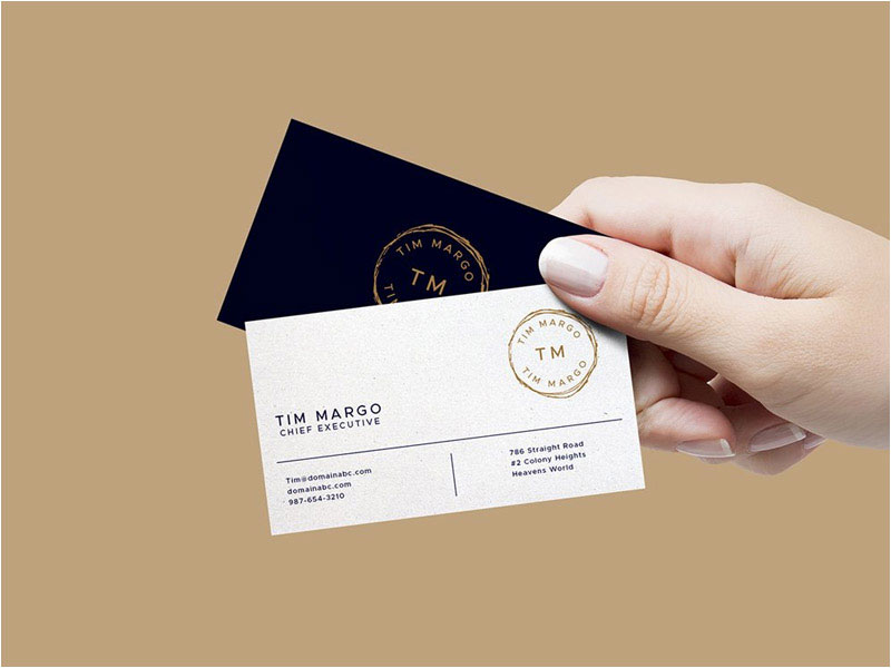 Hand-Holding-Business-Cards-Mockup